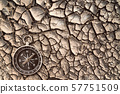 Top view of compass on the cracked dry soil 57751509