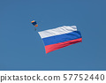 A man flying in the sky with opened parachute and russian flag 57752440