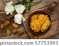 Almond cookies in a rustic bowl 57753903