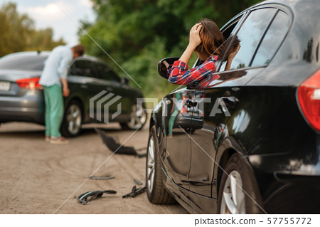 Male and female drivers after car accident on road 57755772