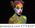 Alluring woman with a body art clown. 57758287