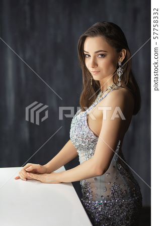 Attractive young lady posing in a studio. 57758332