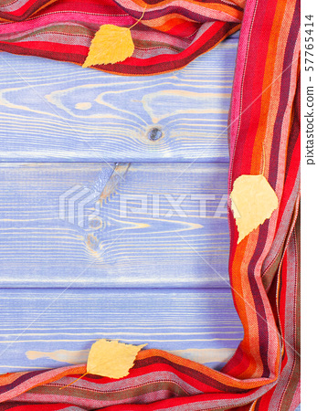 Frame of shawl for woman and leaves on boards 57765414