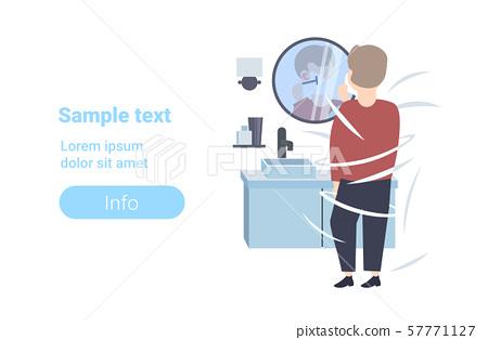 man shaving his face rear view guy looking at mirror modern home bathroom interior flat full length 57771127