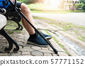 Old people using crutches at public park 57771152