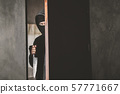 The thief holds a knife to open the house door for 57771667
