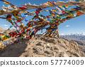 Colorful tibetan prayer flags on rock mountain in 57774009