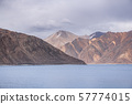 Pangong Lake with rocky mountains situated on the 57774015