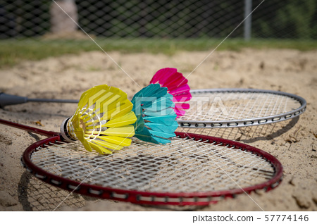 Colorful shuttlecocks with a badminton net 57774146