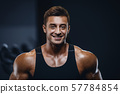 Handsome strong athletic men pumping up muscles 57784854