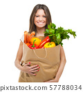 Young woman holding a bag full of vegetables 57788034