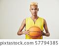 Sportsman posing with baskball ball 57794385