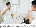 Young Asian man brushing teeth 57795226