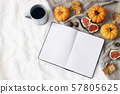Autumn breakfast in bed. Blank open notebook mockup. Cup of coffee, colorful leaves, figs and little 57805625