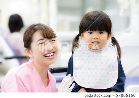 Dental hygienist and child 57806166