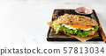 Healthy sandwich with salmon on white background 57813034