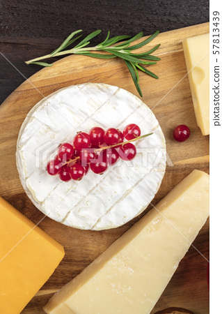 Camembert cheese, overhead shot with other cheeses and fruit 57813439
