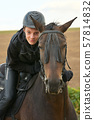 Teenage boy with a horse 57814832
