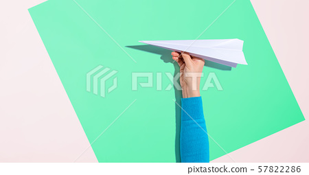 Person holding a paper airplane 57822286