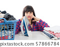 unhappy young beautiful woman ironing clothes 57866784
