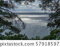 Beautiful view of the Black Sea from top of the hill of the green rain forest. Sun light reflection. 57918597