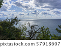Beautiful view of the Black Sea from top of the hill of the green rain forest. Sun light reflection. 57918607