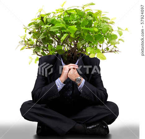 man with a tree on the head 57924097