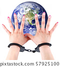 planet Earth with hands and handcuffs 57925100