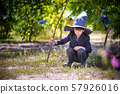 Toddler boy in pointed hat playing with magic wand 57926016