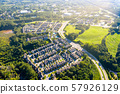Aerial picture suburban gated community southern united states during sunset and sunrays 57926129