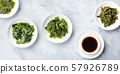 A panorama of seaweed, sea vegetables, with a sauce, top shot 57926789