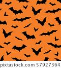 Seamless pattern with bats on orange background, vector illustration 57927364