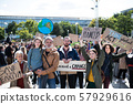 People with placards and posters on global strike for climate change. 57929616