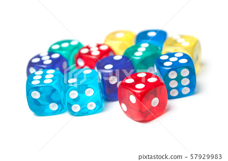 Closeup of colorful dices on white background 57929983
