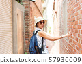 woman walking in the old street at Lukang town 57936009