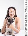 Beautiful Asian woman smile with her dog Pug breed happiness with friendly pet,isolated on white background 57939111