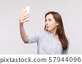 Young woman making selfie with smartphone.funny 57944096