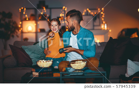 family   father and child daughter watching 57945339