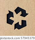 Rough paper texture with recycle symbol 57945379