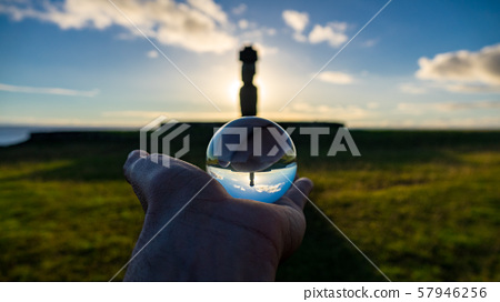 Backlit of isolated Moai with Pukao in Rapa Nui through crystal ball 57946256
