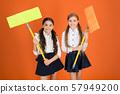 Super duper cleaning. Cute schoolgirls holding 57949200