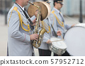 A wind instrument parade - a man playing saxophone 57952712