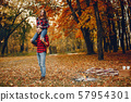 Elegant couple spend time in a autumn park 57954301