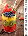 Fresh fruits mix which strawberry, kiwi, grapes and papaya in a glass on wood for healthy 57955838