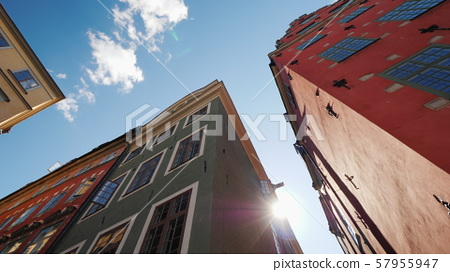 Multicolored old houses in Stockholm. Beautiful European architecture, the sun shines from behind 57955947