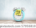 3d rendering of blue alarm clock with yellow 'Wake up' sign on white wooden floor and white wall 57956810