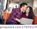 happy young couple kissing in the office 57959124