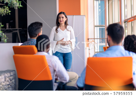 Business meeting in a modern office with young people 57959355