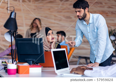 Multiethnic startup business team on meeting in modern bright office interior brainstorming, working 57959828
