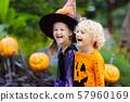 Child in Halloween costume. Kids trick or treat. 57960169